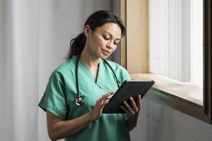 nurse using tablet