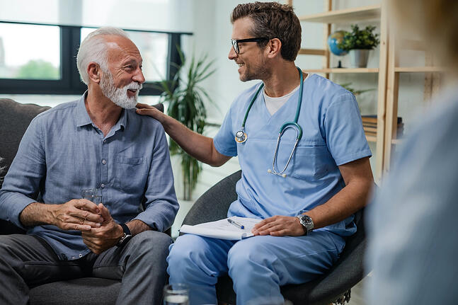 patient benefiting from remote patient monitoring talking to his doctor