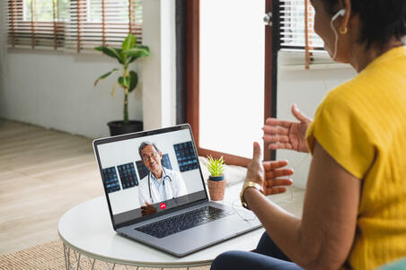 Women doing virtual visit doctor's appointment with her physician