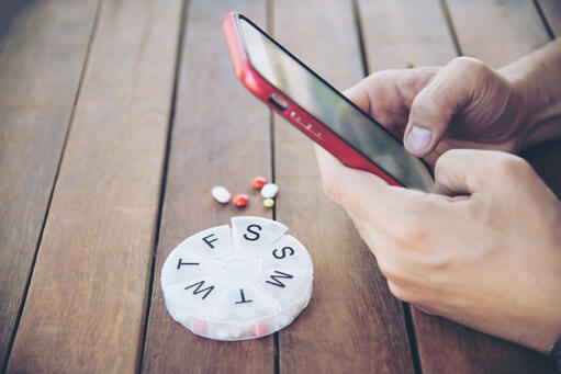 Telehealth medication reminder on mobile phone