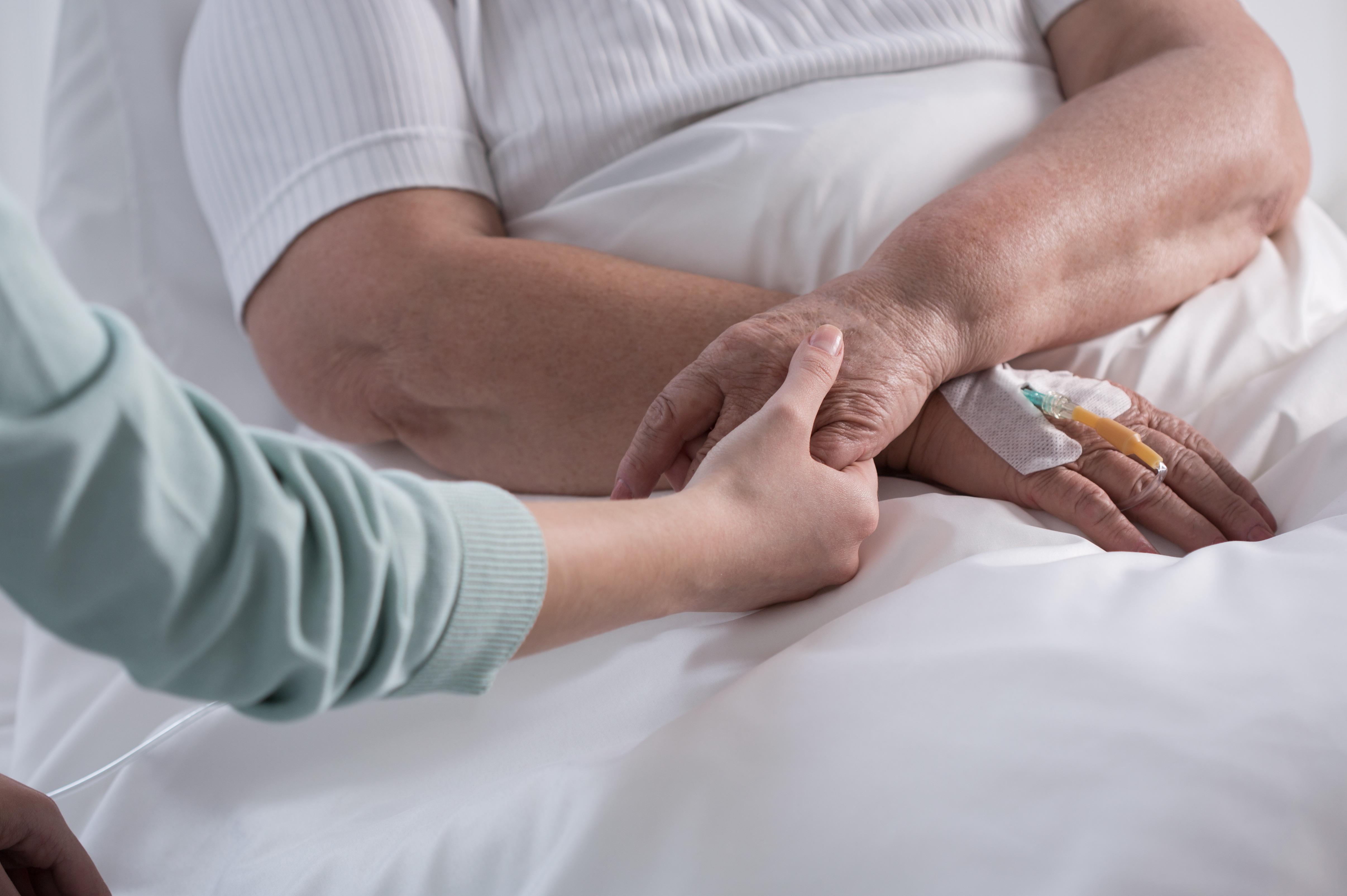 Nurse comforts palliative care patient