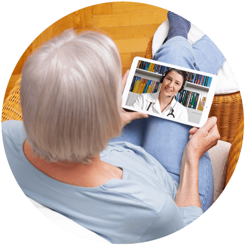 Elderly woman using telehealth tablet
