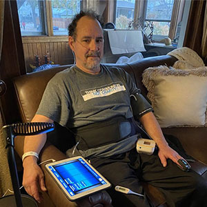 Greg, the patient using HRS solutions to manage COVID-19 at home